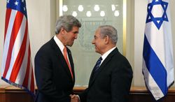 U.S. Secretary of State John F. Kerry (left) meets with Israeli Prime Minster Benjamin Netanyahu in Jerusalem on Thursday, May 23, 2013. The United States and Israel are raising hopes for a restart of the Middle East peace process after more than four years of hardly any talks. (AP Photo/Jim Young, Pool)