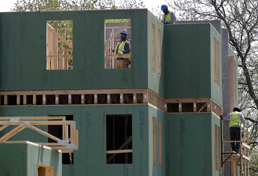 Workers construct a new housing complex in Trenton, N.J., on Wednesday, April 24, 2013. (AP Photo/Mel Evans)
