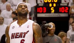Miami Heat forward LeBron James (6) scored in the last seconds of overtime to defeat the Indiana Pacers in Miami on Tuesday May 22, 2013. (AP Photo/The Palm Beach Post, Allen Eyestone)