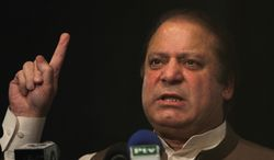 Former Pakistani Prime Minister Nawaz Sharif, who will lead the nation's incoming government, addresses political-party workers in Lahore, Pakistan, on Monday, May 20, 2013. (AP Photo/K.M. Chaudary)