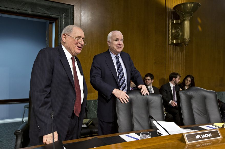 **FILE** Sens. Carl Levin (left), Michigan Democrat and Chairman for the Senate Homeland Security and Governmental Affairs Permanent subcommittee on Investigations, and John McCain of Arizona, the subcommittee's ranking Republican, arrive on Capitol Hill in Washington on May 21, 2013, for the subcommittee's hearing to examine the methods employed by multinational corporations to shift profits offshore and how such activities are affected by the Internal Revenue Code. (Associated Press)