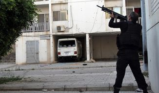 ** FILE ** A Sunni gunman fires his machine gun during clashes that erupted between pro- and anti-Syrian regime gunmen, in the northern port city of Tripoli, Lebanon, Thursday, May. 23, 2013. (AP Photo)