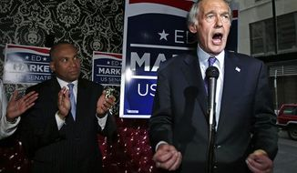 Mass. Gov. Deval Patrick, left, applauds while joining Democratic U.S. Senate nominee, U.S. Rep. Ed Markey, D-Mass., at a campaign event in Boston, Wednesday, May 8, 2013. Markey is running against Republican Gabriel Gomez in the June 25 special election. (Associated Press)