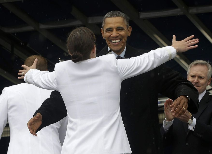 President Barack Obama congratulates Alexis Marisa Werner with open arms during the United States Naval Academy commencement ceremony in Annapolis, Md., Friday, May 24, 2013. (AP Photo/Pablo Martinez Monsivais)