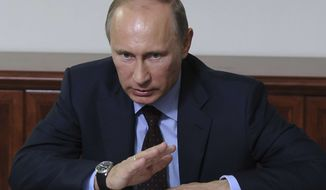 Russian President Vladimir Putin meets with Russian entrepreneurs while visiting a SIBUR Holding petrochemical plant in Voronezh, 534 km (334 miles) south of Moscow, Russia, Thursday, May 23, 2013. (AP Photo/RIA-Novosti, Mikhail Klimentyev, Presidential Press Service)