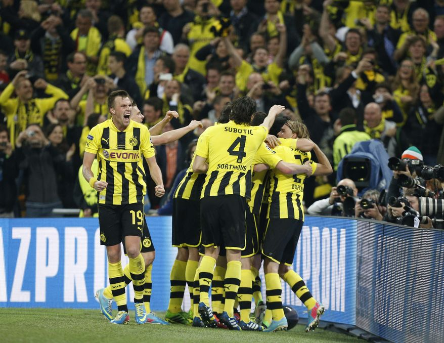 Borussia Dortmund players react after their side scored their first goal, during the Champions League Final soccer match between Borussia Dortmund and Bayern Munich, at Wembley Stadium in London, Saturday May 25, 2013. (AP Photo/Jon Super)