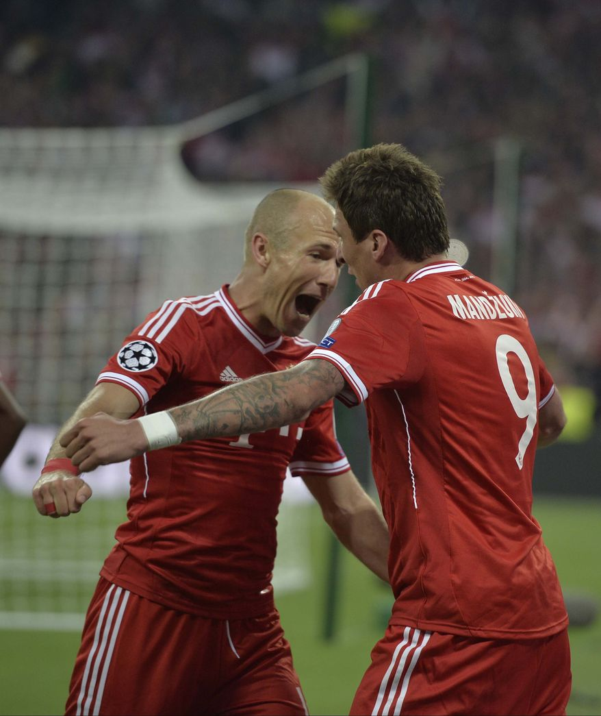 Bayern's Mario Mandzukic of Croatia, right, celebrates scoring the opening goal with Arjen Robben of the Netherlands, during the Champions League Final soccer match between Borussia Dortmund and Bayern Munich at Wembley Stadium in London, Saturday May 25, 2013. (AP Photo/Martin Meissner)