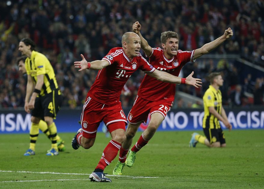 Bayern's Arjen Robben of the Netherlands, center left, celebrates scoring the winning goal, with Thomas Mueller, during the Champions League Final soccer match between Borussia Dortmund and Bayern Munich at Wembley Stadium in London, Saturday May 25, 2013. (AP Photo/Matt Dunham)
