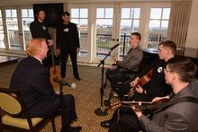 MusiCorps musicians perform at a reception for Bob and Lee Woodruff. A foundation named for Mr. Woodruff, an ABC journalist who was wounded during the war in Iraq, awarded a grant last summer that makes it possible for the wounded warriors to travel and perform their music across the country.