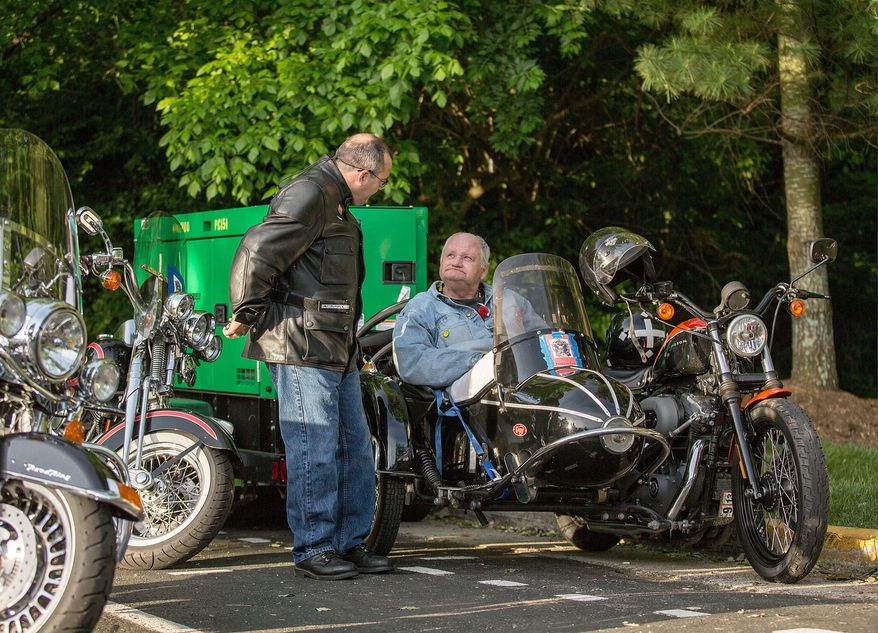 Matt Morrow (left) and Lea Daniels (right), prepare to ride to the Pentagon in the annual Ride of the Patriots, in support of Rolling Thunder, in Fairfax, VA., Sunday, May 26, 2013. (Andrew S Geraci/The Washington Times)