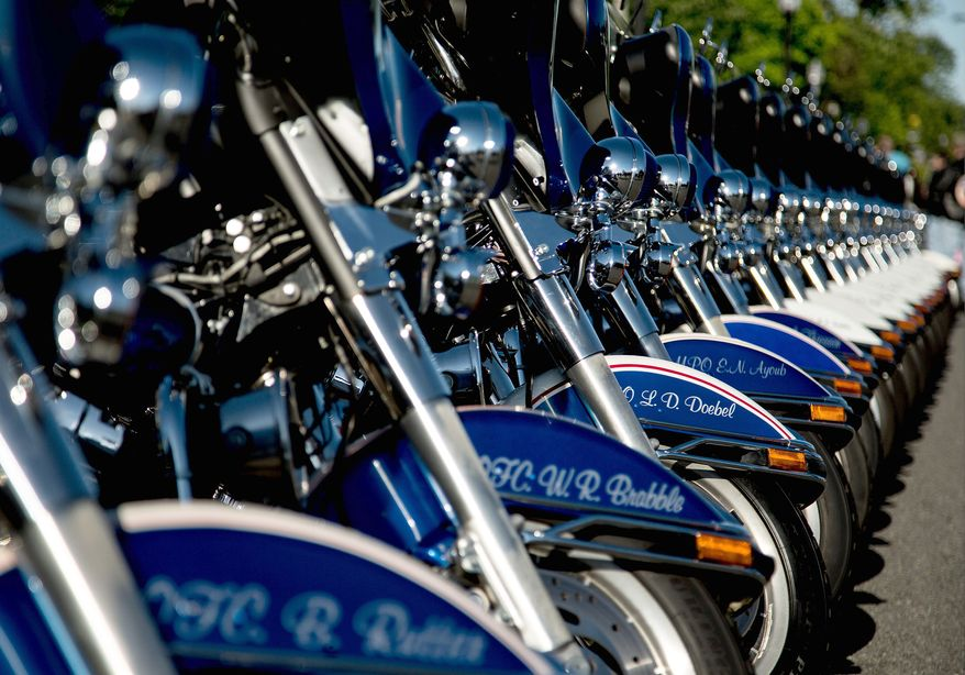 Fairfax County motorcycle police bikes line the street, outside the Patriot Harley-Davidson in preparation to escort rides in the annual Ride of the Patriots, in support of Rolling Thunder, in Fairfax, Va., Sunday, May 26, 2013. (Andrew S. Geraci/The Washington Times)