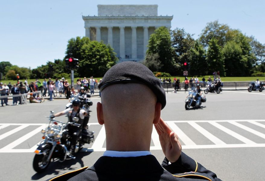 Flags and salutes were the order of the day Sunday as miles of motorcycles crossed Memorial Bridge en route to the Mall in the 26th annual Rolling Thunder Ride for Freedom. (Associated Press)