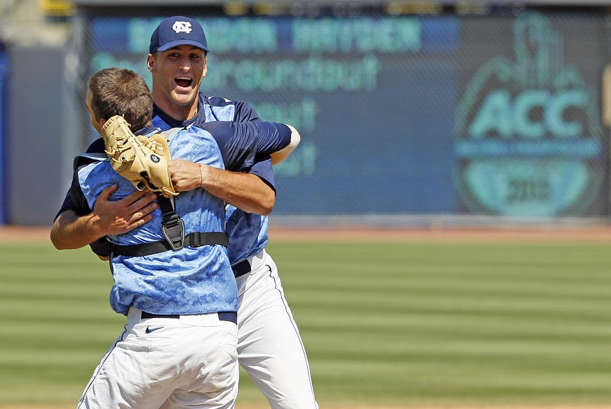 North Carolina relief pitcher Trevor Kelley, right, celebrates with catcher Matt Roberts Carolina's 4-1 win over Virginia Tech in the Championship game of the ACC Tournament Sunday, May 26, 2013, in Durham, N.C. (AP Photo/Karl B DeBlaker)