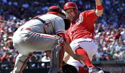 Washington Nationals' Ryan Zimmerman, right, slides safely into home as Philadelphia Phillies catcher Humberto Quintero cannot handle the throw during the seventh inning of a baseball game at Nationals Park, Sunday, May 26, 2013, in Washington. The Nationals won 6-1. (AP Photo/Alex Brandon)
