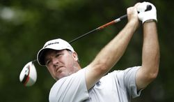 Boo Weekley watches his tee shot on the sixth hole during the final round of the Colonial golf tournament, Sunday, May 25, 2013, in Fort Worth, Texas. (AP Photo/LM Otero)