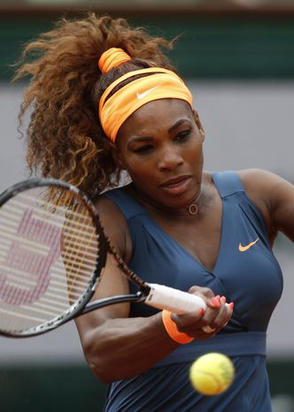 Serena Williams, of the USA, returns the ball to Georgia's Anna Tatishvili during their first round match of the French Open tennis tournament at the