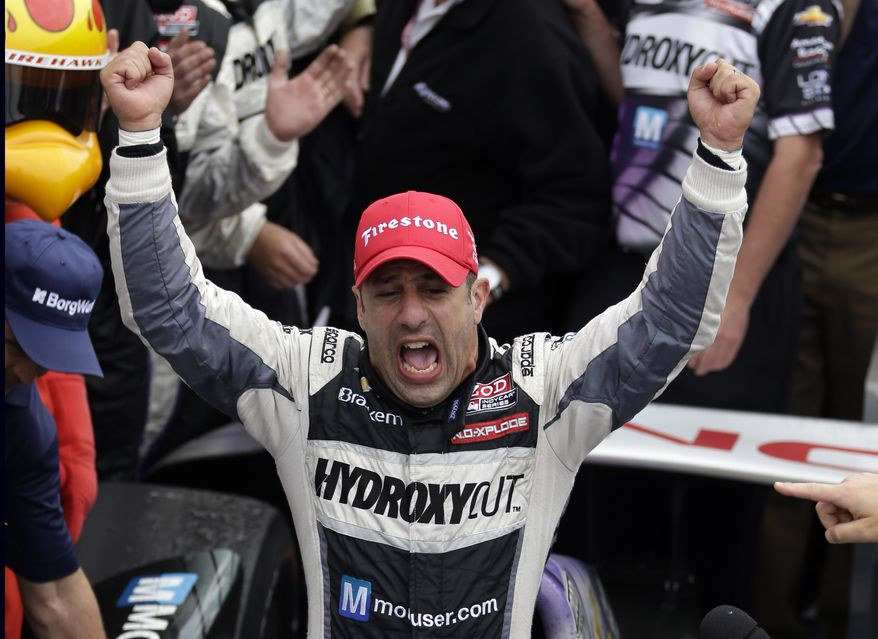 Tony Kanaan, of Brazil, celebrates after winning the Indianapolis 500 auto race at the Indianapolis Motor Speedway in Indianapolis, Sunday, May 26, 2013. (AP Photo/Michael Conroy)