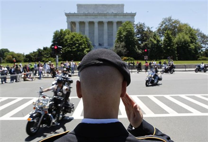 """Motorcycles participate in the annual Rolling Thunder """"Ride for Freedom"""" parade ahead of Memorial Day in Washington, Sunday, May 26, 2013. (AP Photo/Molly Riley)"""