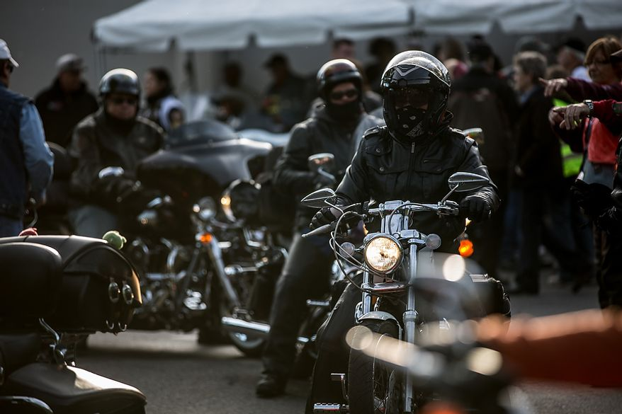 Volunteers and members of the Fairfax VA Chapter, Harley Owners Group, check their bikes as they to prepare to ride to the Pentagon in the annual Ride of the Patriots, in Fairfax, VA., Sunday, May 26, 2013.  (Andrew S Geraci/The Washington Times)