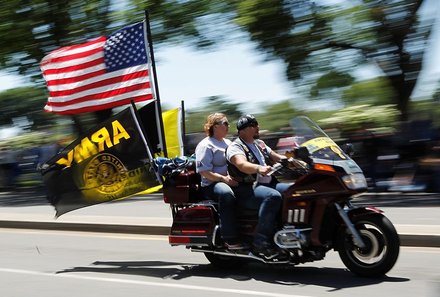 "Motorcycle riders participate in the annual Rolling Thunder ""Ride for Freedom"" ahead of Memorial Day in Washington, Sunday, May 26, 2013. (AP Photo/Molly Riley)"