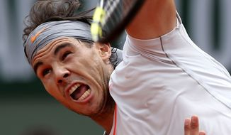 Spain's Rafael Nadal serves the ball to Germany's Daniel Brands during their first round match of the French Open tennis tournament at the Roland Garros stadium Monday, May 27, 2013 in Paris. (AP Photo/Michel Euler)