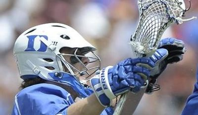Duke's Josh Offit, left, and Jake Tripucka (7) celebrate after Tripucka scores a goal in the first half of an NCAA college Division I championship final lacrosse game against Syracuse on Monday, May 27, 2013, in Philadelphia. (AP Photo/Michael Perez)
