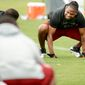 Washington Redskins strong safety Brandon Meriweather (31) stretches during organized team activities at Redskins Park, Ashburn, Va., Thursday, May 23, 2013. (Andrew Harnik/The Washington Times)