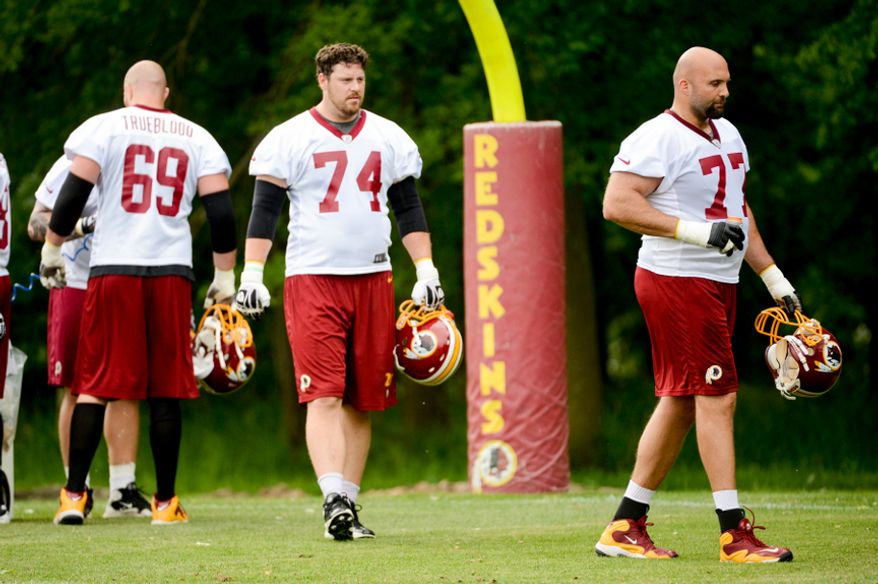 Left to right: Washington Redskins tackles Jeremy Trueblood (69), Washington Redskins tackle Tyler Polumbus (74), and Tony Pashos (77) during organized team activities at Redskins Park, Ashburn, Va., Thursday, May 23, 2013. (Andrew Harnik/The Washington Times)
