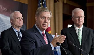 ** FILE ** In this May 23, 2013, file photo Republican Senators Lindsey Graham, R-S.C., center, Sen. John McCain, R-Ariz., left, and Saxby Chambliss, R-Ga., right, take part in a Capitol Hill press conference in Washington to express criticism of President Barack Obama's speech on Afghanistan, terrorism, and the Guantanamo Bay prison. (AP Photo/J. Scott Applewhite, File)