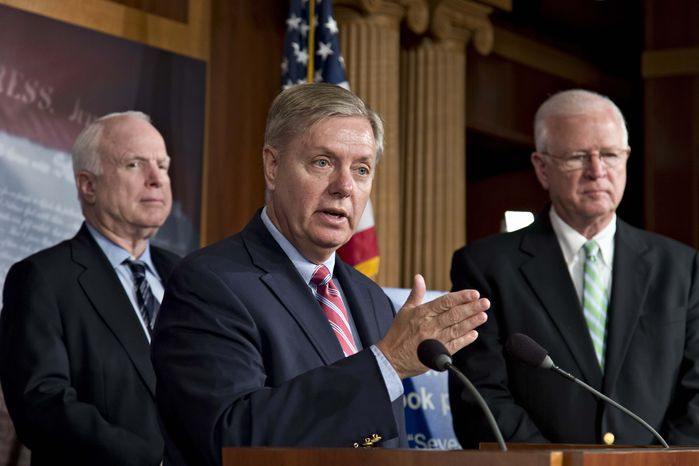 ** FILE ** In this May 23, 2013, file photo Republican Senators Lindsey Graham, R-S.C., center, Sen. John McCain, R-Ariz., left, and Saxby Chambliss, R-Ga., right, take part in a Capitol Hill press conference in Washington to express criticism of President Barack Obama's speech on Afghanistan, terrorism, and the Guantanamo Bay prison. (AP Photo/J. Scott Applewhit
