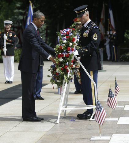 President Barack Obama participates in the wreath-laying ceremony at the Tomb of the Unknowns at Arlington National Cemetery on Memorial Day, May 27, 2013, in Arlington, Va. (AP Photo/Pablo Martinez Monsivai