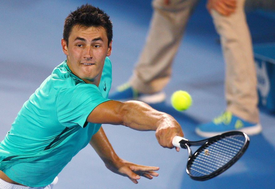 FILE - In this Saturday, Jan. 12, 2013 file photo Australia's Bernard Tomic plays a shot to Kevin Anderson of South Africa during the men's final at the Sydney International tennis tournament in Sydney, Australia. Bernard Tomic's hitting partner Thomas Drouet has called for the father of the Australian tennis player to be banned after he was allegedly assaulted on Saturday May 4, 2013. John Tomic has been charged with assault after allegedly headbutting Drouet ahead of this week's Madrid Open. (AP Photo/Rick Rycroft, File)