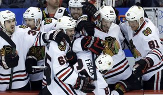 Chicago Blackhawks center Michael Frolik (67), of the Czech Republic, celebrates scoring a penalty shot goal against the Detroit Red Wings goalie Jimmy Howard during the third period in Game 6 of the Western Conference semifinals in the NHL hockey Stanley Cup playoffs in Detroit, Monday, May 27, 2013. (AP Photo/Paul Sancya)