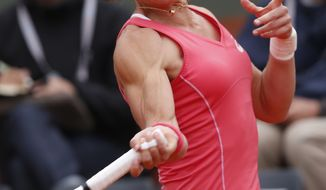 ustralia's Samantha Stosur returns the ball to Japan's Kimiko Date-Krumm during their first round match of the French Open tennis tournament at the Roland Garros stadium Tuesday, May 28, 2013 in Paris. (AP Photo/Petr David Josek)