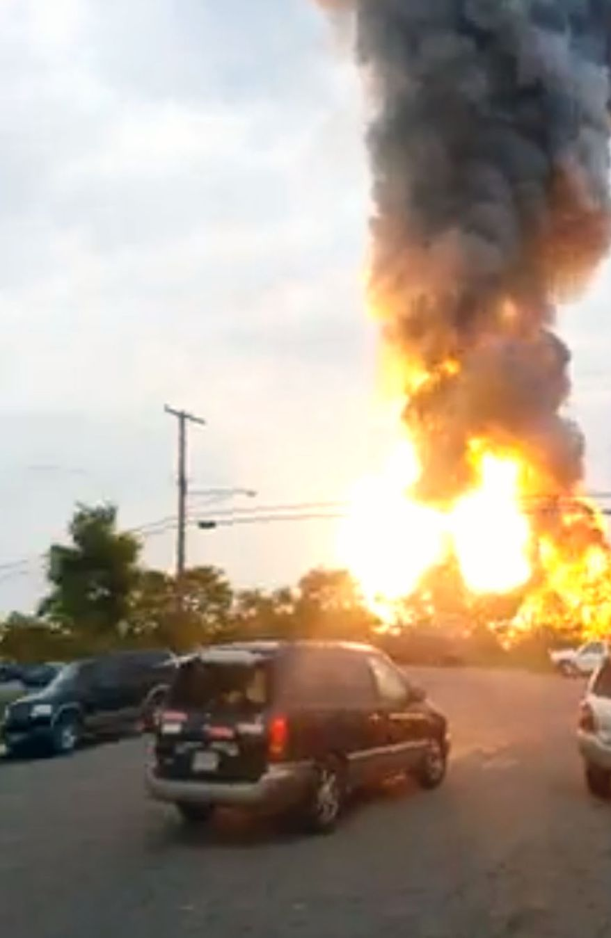 This still taken from video provided by James LeBrun shows an explosion outside Baltimore on May, 28, 2013. Baltimore County fire officials say a train derailed in a Baltimore suburb on Tuesday and an explosion was heard in the area. A fire spokeswoman says the train derailed about 2 p.m. in White Marsh, Md. (Associated Press)