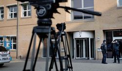 ** FILE ** Camera tripods stand outside a courthouse in Copenhagen, Denmark, Friday April 13, 2012, prior to the start of a case. (Associated Press)