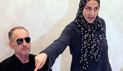 ** FILE ** Zubeidat Tsarnaeva, the mother of the two Boston Marathon bombing suspects, has said authorities are wrong to suspect her sons of the bombings. Her husband, Anzor Tsarnaev, is beside her. (Associated Press)