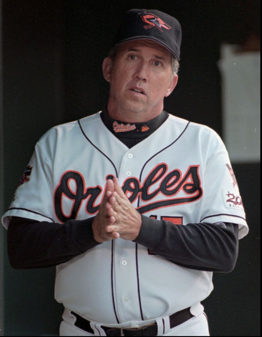 **FILE** Baltimore Orioles manager Davey Johnson reflects in the dugout at Camden Yards in Baltimore Aug. 27, 1997 during a game against the Kansas City Royals. (AP Photo/Roberto Borea)