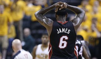 Miami Heat's LeBron James reacts after he was called for a technical foul during the first half against the Indiana Pacers in Game 4 of the NBA basketball Eastern Conference finals, Tuesday, May 28, 2013, in Indianapolis. (AP Photo/Michael Conroy)