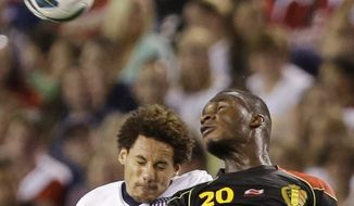 Belgium forward Christian Benteke (20) heads the ball away from United States' Jermaine Jones (13) in the second half of an international friendly soccer game Wednesday, May 29, 2013, in Cleveland. Belgium won 4-2. (AP Photo/Tony Dejak)