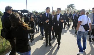 ** FILE ** Vincent Autin (center left) and Bruno Boileau (center right) arrive at City Hall in Montpellier, France, for their civil wedding on Wednesday, May 29, 2013. Mr. Boileau, 30, of Paris, and Mr. Autin, 40, are the first same-sex couple to marry in France since the government passed legislation legalizing same-sex marriage. (AP Photo/Remy de la Mauviniere)