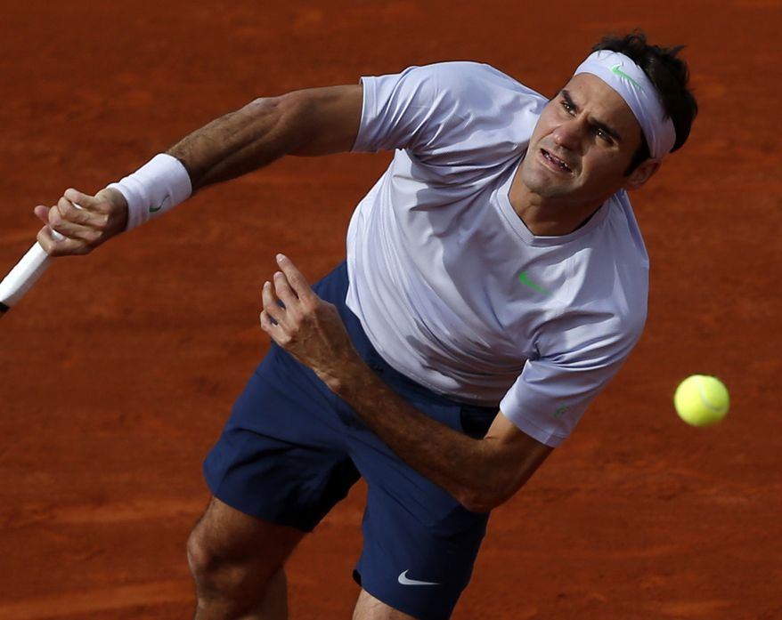 Switzerland's Roger Federer serves the ball to India's Somdev Devvarman during their second round match of the French Open tennis tournament at the Roland Garros stadium Wednesday, May 29, 2013 in Paris. (AP Photo/Petr David Josek)