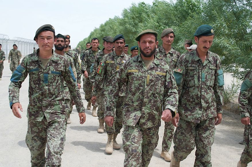 Afghan National Army soldiers march in formation on May 9, 2013 at Camp Shorabak, an Afghan base in Southwest Afghanistan where they live, train and take courses. (Credit: Kristina Wong/The Washington Times)