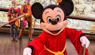 """** FILE ** Mickey Mouse appears in the live show """"Mickey and the Magical Map,"""" a 22-minute song-and-dance extravaganza, at the Fantasyland Theatre in Disneyland Park in Anaheim, Calif., on Friday, May 10, 2013. (AP Photo/Disneyland Resort, Paul Auyeung)"""