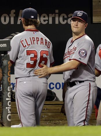 Nationals right-hander Jordan Zimmermann consoles reliever Tyler Clippard after the two combined to allow six runs to the Orioles in the seventh inning on Wednesday night and blow a three-run lead. (Associated Press photo)