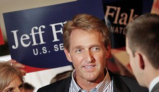 """For years now we've been hearing about dysfunction in the Congress. We've all suffered in our public opinion polling and what people think of this place, and I think this process we've gone through in the last couple of days, last couple of weeks, are a real antidote to that,"" said Sen. Jeff Flake of Arizona. (Associated Press)"