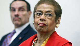 **FILE** Eleanor Holmes Norton (right), a non-voting delegate for the District of Columbia in the House of Representatives, and D.C. Mayor Vincent Gray, take part in a news conference on Capitol Hill in Washington on May 29, 2012. (Associated Press)