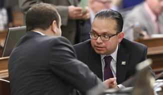 Assemblyman Luis Alejo, D-Watsonville, right, talks with Assemblyman Adrin Nazarian, D-Sherman Oaks, during the Assembly session at the Capitol in Sacramento, Calif., Wednesday, May 29, 2013. By a 53-20 vote the Assembly approved Alejo's measure, AB60, which would allow those without a Social Security number to apply for a drivers license. The bill was sent to the Senate. (AP Photo/Rich Pedroncelli)