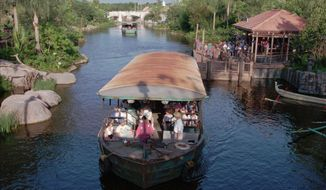 ** FILE ** In this April 22, 1998, file photo, a river boat leaves the dock at Safari Village in Disney's Animal Kingdom in Lake Buena Vista, Fla. A Walt Disney World patron on a ride with her grandson found a loaded gun on her seat on the Dinosaur ride at Animal Kingdom, officials said Wednesday, May 29, 2013. (AP Photo/Peter Cosgrove, File)