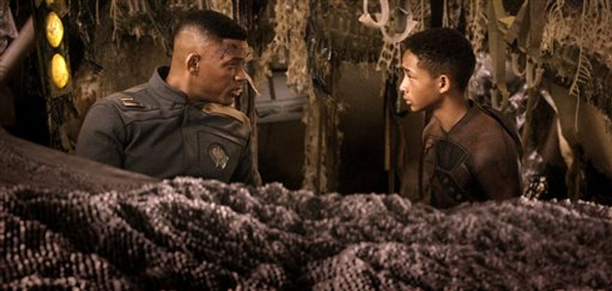 "Will Smith, left, and Jaden Smith in a scene from ""After Earth."" (AP Photo/Sony, Columbia Pictures)"
